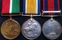 A SCARCE EDWARD VII TRANSPORT MEDAL (S,AFRICA 1902), WAR MEDAL & MERCANTILE MARINE MEDAL TRIO. To: Chief Officer JOHN ARMOUR. (MERCHANT NAVY). One of only 1219 medals.